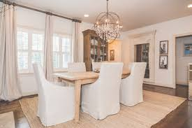 traditional dining room with pendant light carpet in mountain refer to foucault orb chandelier