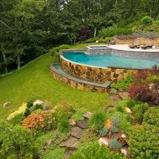 backyard infinity pools. Stunning Infinity Pool An Arc-shaped With A Spa Is Built Into The Hillside, Where Cascading Water Gently Rolls Over Misty Rose Flagstone Veneered Backyard Pools