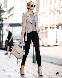 modern new yorker style grey biker jacket black skinnies and studded pumps 2019