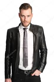 attractive man in a leather jacket and tie stock image