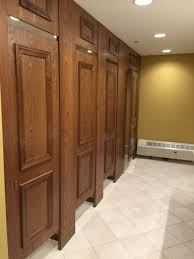 Ironwood Manufacturing wood veneer toilet partitions and bathroom