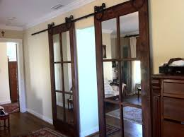 Overlapping Sliding Barn Doors We Both Absolutely Want This In Place Of Swinging French Doors
