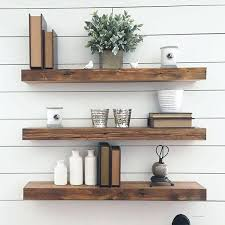 wall shelves wooden thick reclaimed wood floating in front of a white plank slatwall shelf