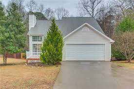 this canton two story offers a gas fireplace granite kitchen countertops a basement