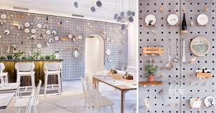 wall decor idea a gray perforated concrete pegboard lines the wall of this cafe for