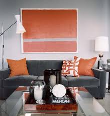 Steel gray and persimmon orange living room colors.