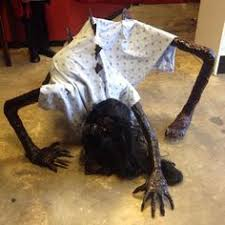 Halloween decoration-crawling creature - need this in a dark corner where  the kids cut through the yard!