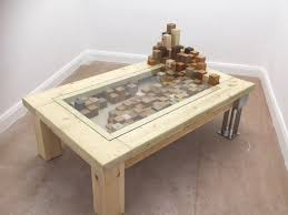 inspired by her mission to raise awareness of youth homelessness within the uk anna s design concept is based on a rectangular table with individual blocks