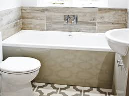 tiling around the bath and in the shower i chose luxury vinyl flooring tiles in a complementary tone with a strong geometric pattern to provide a good