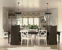 black and white dining table set:  table with brown slipcovered dining chairs view full size