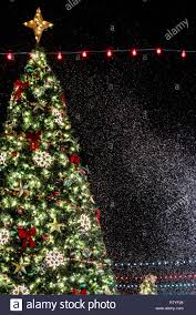 Falling Christmas Tree Lights Christmas Tree Background With Beautiful Lights And Snow