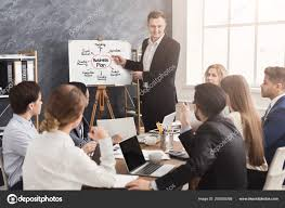 Businessman Presenting Business Plan To His Colleagues Stock Photo