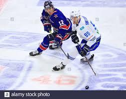 ST PETERSBURG, RUSSIA - JANUARY 23, 2020: SKA St Petersburg's Jori Lehtera  (L) and Barys Nur-Sultan's Dmitry Shevchenko fight for the puck in the  2019/20 KHL Regular Season ice hockey match between