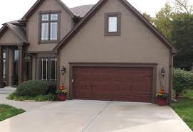 walnut garage doorsclopay gallery garage door  ultra grain walnut oak  wrought iron