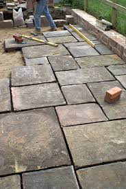 do it yourself how to build a dry stone patio i like the natural stone border me casa dry stone stone patios and natural stones
