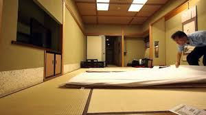 traditional japanese bedroom. Fine Traditional Making Up A Futon Bed At Japanese Traditional Ryokan Throughout Traditional Bedroom G