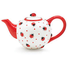 a lady bug tea pot designed from pottery painting