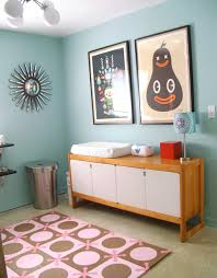 Girly retro nursery. Can't help but smile back at the smiling pear.