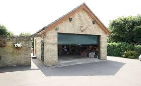 black roller garage door on detached garage