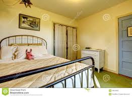 country home bedroom with iron bed and old door