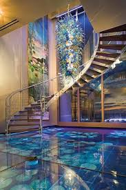 Glass floor with pond underneath in Acqua Liana, Florida This gorgeous house  is my worst nightmare! Glass floors & fish tanks built in everywhere.