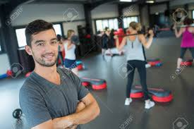 gym instructor gym instructor posing stock photo picture and royalty free image