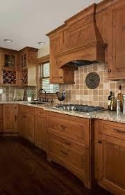 knotty alder kitchen cabinets wood hood and wine rack cabinet corner kitchen remodel design by knotty knotty alder kitchen cabinets