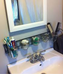 30 diy bathroom storage ideas. i love the use of mason jars as a sink / countertop organizer! what great way to keep small bathroom clutter free. this would be diy project for 30 diy storage ideas