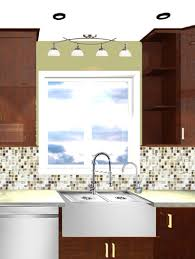 over the sink lighting. weu0027d probably move some of those recessed lights over at this point the sink lighting o