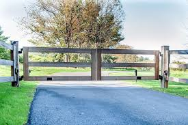 This fence idea is a great way to hide unsightly things in your yard, like an ac unit. Post And Rail Automatic Wooden Driveway Gate Wooden Gates Driveway Fence Design Driveway Gate Diy