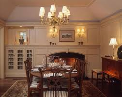 small traditional dining room interior with wooden dining furniture and white fireplace with traditional dining room