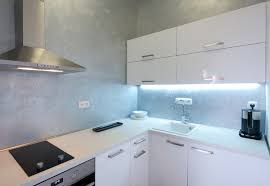 the old design rule of thumb applies to small kitchens use light colors to visually increase the size of a small space in this diminutive corner kitchen