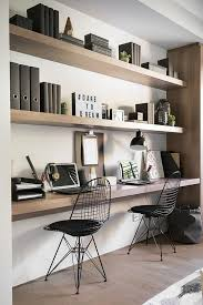 floating shelves and a matching desk under them for a modern and laconic home office