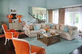 Light Blue Coastal Living Room With Orange Armchairs & Beige Sectional