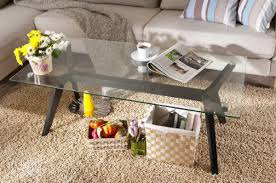 nice glass coffee table gold legs that can be applied on the cream rug can add