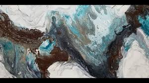 pouring acrylic paint on wet canvas and dragging paint to create a painting