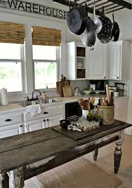 farmhouse kitchens. an antique weathered table could become a perfect farmhouse kitchen island. kitchens
