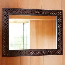 brown wood cutout wall mirror