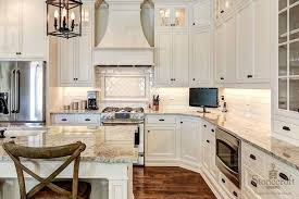 oil rubbed bronze hardware. Interesting Rubbed Traditional Kitchen Features Ivory Cabinetry Accented With Oilrubbed  Bronze Hardware And Golden Irish Sun Countertops Alongside A Classic Subway Tiled  For Oil Rubbed Bronze Hardware I