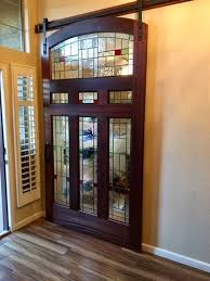 arched barn door with stained glass