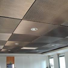 drop ceiling tiles painted with metallic aluminum paint. paint tiles  covered with a thin metal