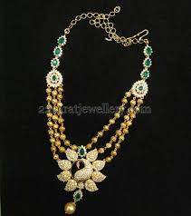 22 carat gold beads triple rows necklace with cz and emerald stones clasps placed all over fl design pendant embellished in the center with peacock