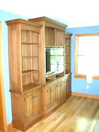 oak entertainment center used cabinet with glass doors wall baby proof