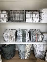 hall closet organization and storage ideas linen closet wire baskets