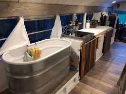 the inside of this bus conversion shows a rare sight a beautiful bathtub