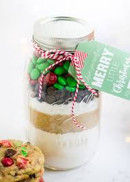 layered cookie mix in a jar recipe that makes the perfect homemade gifts these