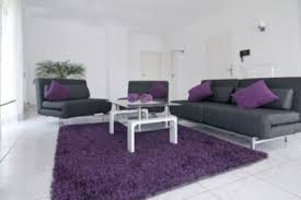 The main use of white and black with the accent of purple makes this room an