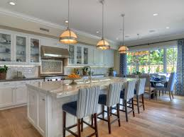 This open-concept kitchen has tons of eat-in area, both at the