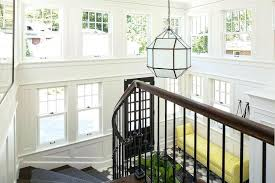 2 story foyer lighting two story foyer features stacked windows illuminated by a lantern over a