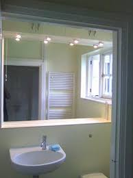 Mirror Design Ideas Awesome illuminated bathroom mirrors made to